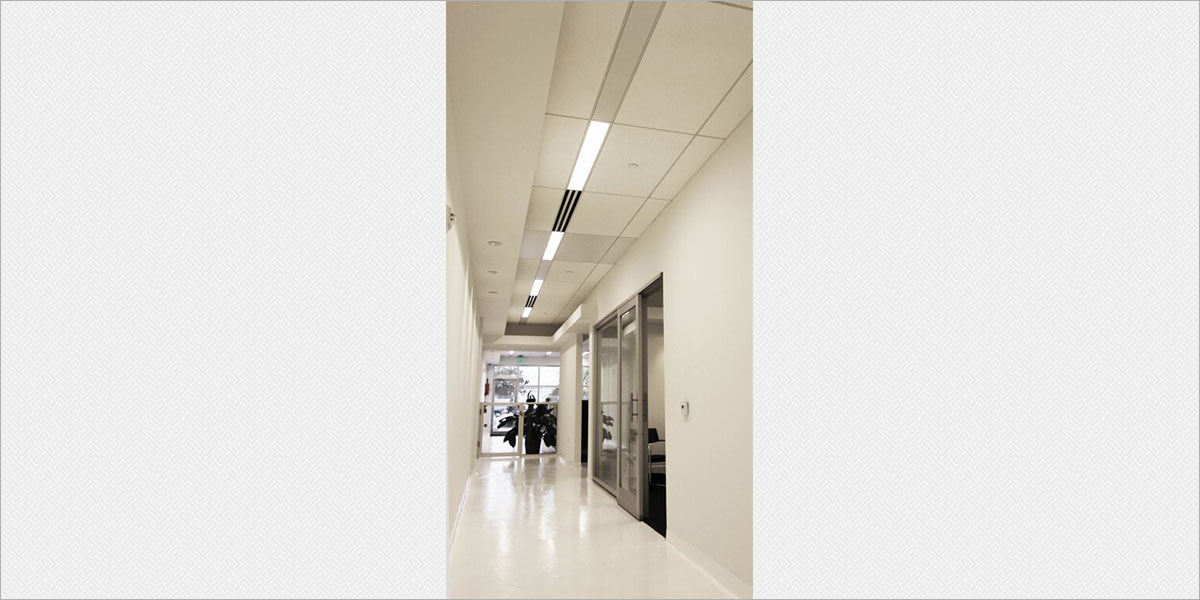 Zumtobel Plateau recessed fluorescent fixtures in the office corridor.