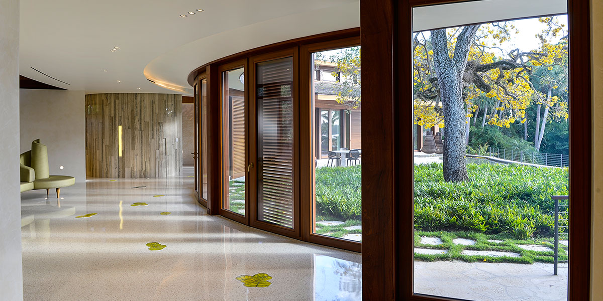 Throughout the terrazzo floor, translucent accents in the form of sea grape leaves are backlit with custom-shaped LED panels manufactured by DLC Lumisheet.