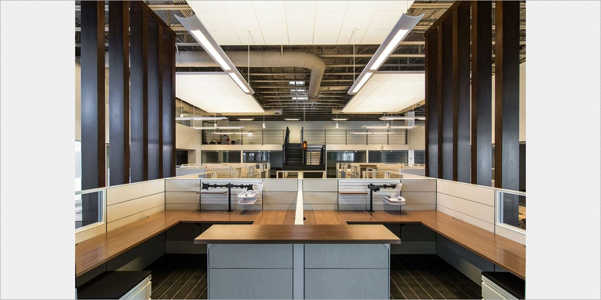 Focal Point Verve IV fluorescent direct / indirect pendants illuminate the suspended acoustic ceiling clouds.