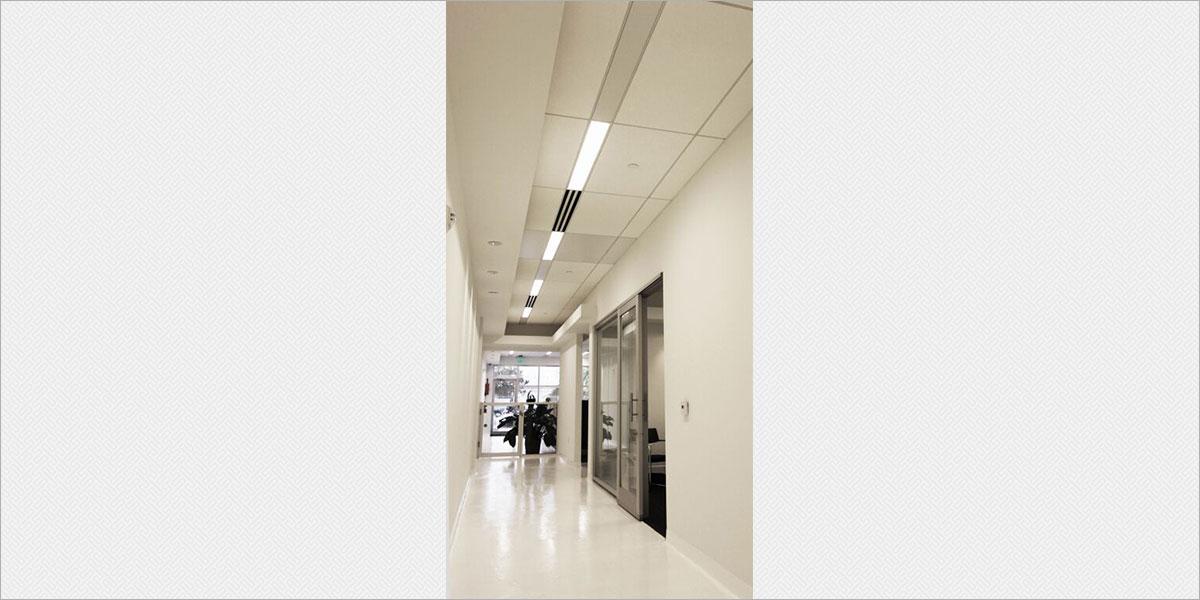 Zumtobel Plateau recessed fluorescent fixtures in the office corridor.